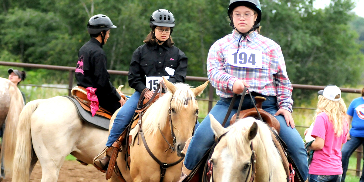 Special Olympics Minnesota equestrian athletes ride their horses